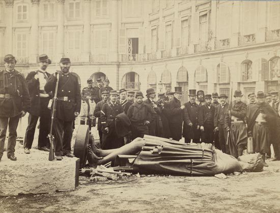 Communards posing at the ruins of the Vendôme column, 16 May 1871.